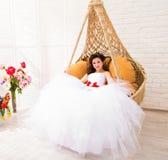 Young bride in wedding dress, studio shot Royalty Free Stock Photo