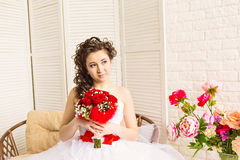 Young bride in wedding dress, studio shot Stock Photos