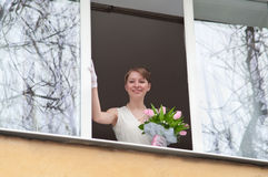 Young bride in window opening Stock Images