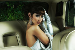 A young bride woman posing in a car Royalty Free Stock Images