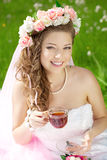 Young bride in a wreath of flowers. Beautiful young bride in a wreath of flowers on her head Royalty Free Stock Photo