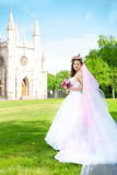 Young bride in a wreath of flowers Royalty Free Stock Images