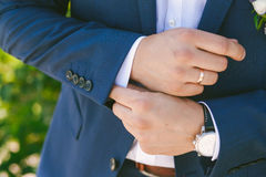 Young bridegroom dressing up Royalty Free Stock Photos