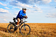 Young bright man on mountain bike Royalty Free Stock Photos