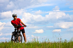 Young bright man on mountain bike Stock Photo
