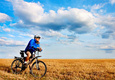 Young bright man on mountain bike Royalty Free Stock Images
