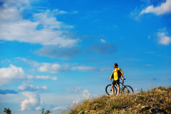 Young bright man on mountain bike Stock Image