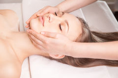 Young bright woman receiving head massage Royalty Free Stock Photos