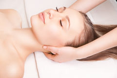 Young bright woman receiving head massage Stock Photos