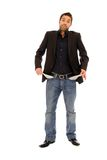 Young broke man. Standing with his Trouser pockets outside royalty free stock images