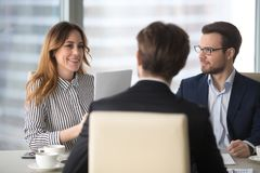 Young broker businesswoman talking to business partners royalty free stock image