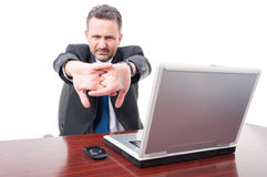 Young broker relaxing and stretching fingers Royalty Free Stock Photo