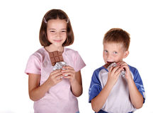 Young brother eat bar of chocolate Stock Images