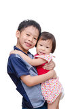 Young brother holding his sister Stock Images