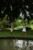 Young Brother And Sister fishing Stock Photo