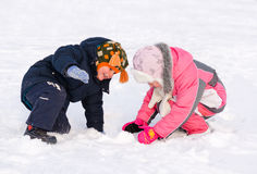 Young brother and sister playing in the snow Stock Photography