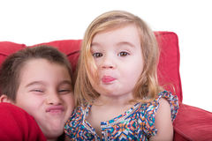 Young brother and sister pulling faces Royalty Free Stock Image