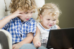 Young Brother and Sister Using Their Computer Laptop Together Royalty Free Stock Photo