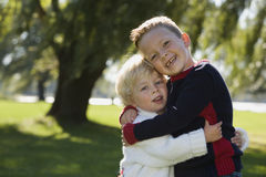 Young brothers hugging. Two brothers having fun together royalty free stock photos