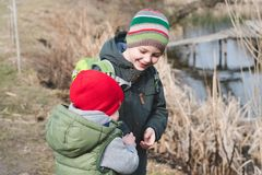 Young brothers hugging each others. Brotherhood friendship concept. Two preschool children boys stay together at the outdoor royalty free stock photos