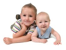Young Brothers Lying on Their Stomachs. On White Background stock photo