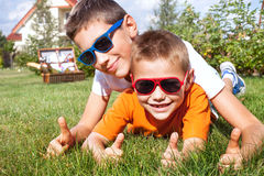 Young brothers playing in the garden. Royalty Free Stock Photos
