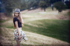 Young brown-haired girl with hat Royalty Free Stock Images