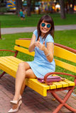 A young brown haired woman in blue dress Stock Photos