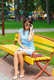 A young brown haired woman in blue dress Stock Images