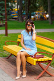 A young brown haired woman in blue dress Royalty Free Stock Photography