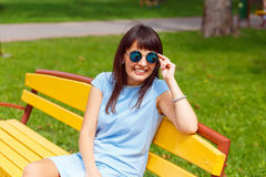 A young brown haired woman in blue dress Royalty Free Stock Photos