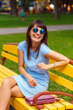 A young brown haired woman in blue dress Stock Image