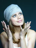 Young brown-haired woman in a grey cap with pastes Stock Images