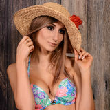 Young brown-haired woman with straw hat Stock Image