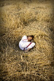 Young brown-haired women on a the field. Portrait of a young brown-haired woman sleeping on a the field of wheat ears in national dress Royalty Free Stock Photos