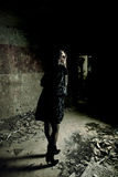 Young brunet at broken house. Young brunet woman standing at abandoned house room Royalty Free Stock Photo