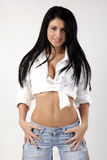 Young brunet girl. Young sexy girl wearing jeans Stock Photo