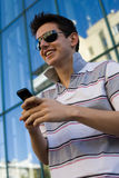 Young brunet with mobile phone Stock Images