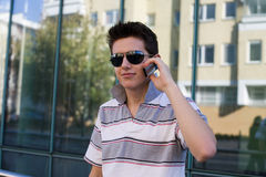 Young brunet with mobile phone Royalty Free Stock Photos