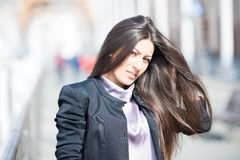 Adjusting my long gorgeous hair Stock Image