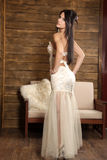 Young brunete model. Young model in a white sexy dress Royalty Free Stock Photo