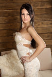 Young brunete model. Young sexy model in a white dress Stock Photos