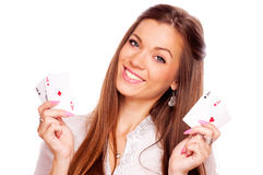 Young brunette with all aces in her hand Royalty Free Stock Images