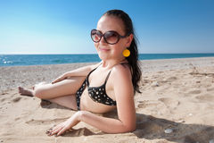 Young brunette on the beach Stock Images