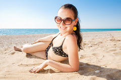 Young brunette on the beach Stock Photos