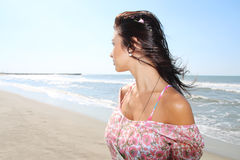 Young brunette at the beach Stock Images