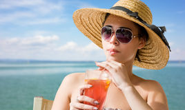 Young brunette with beach refreshment. Stock Images