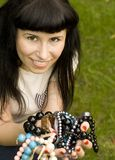 Young brunette with beads Stock Image