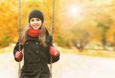 A young brunette on a beautiful autumn background Royalty Free Stock Photos