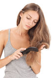 Young brunette beautiful lady combing long hairs Stock Image